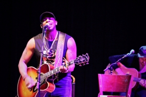 Jimmie Allen performs at a WQMX Charity Concert